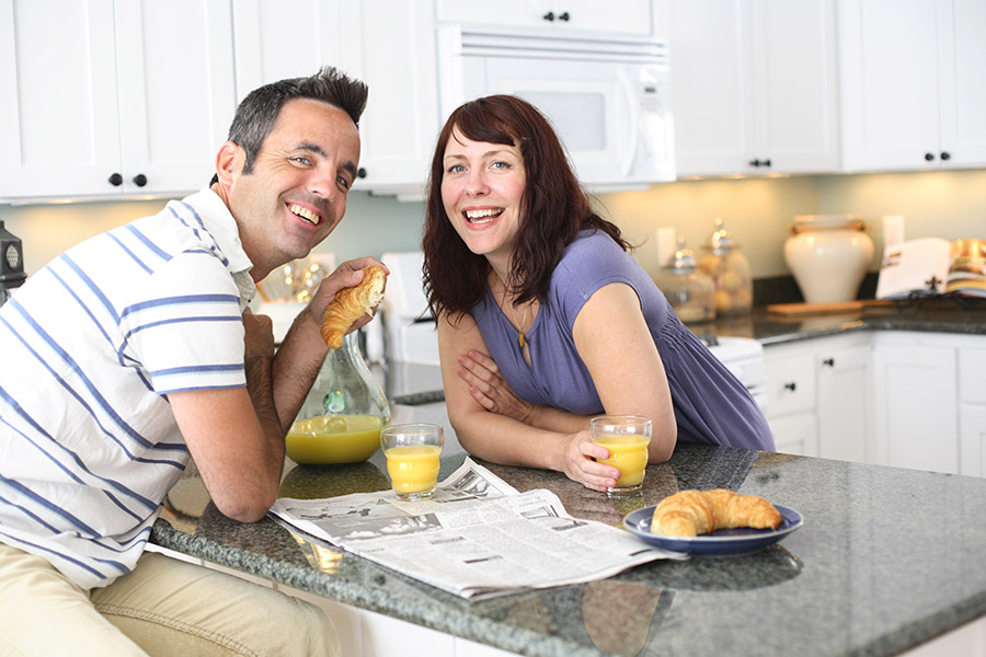 Photograph of a couple enjoying time together in the kitchen